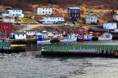 Protective wall and entrance to Petty Harbor. Moored fishing Boats. Royalty Free Stock Images