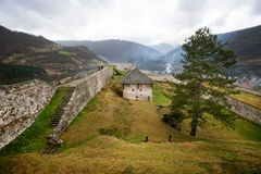 Protective walls of the ancient fortress Stock Photos