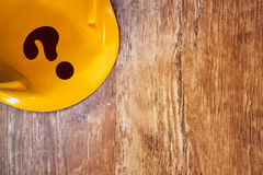 Protective yellow construction helmet with question mark Royalty Free Stock Photo