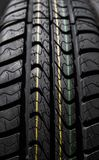 Protector of automobile tires. Close up view on auto mobile new wheel tire surface. Car constraction industry commercial. Transport transpotration Royalty Free Stock Photos