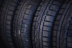 Protector of automobile tires. A number of automobile tires. Close up view on auto mobile new wheel tire s. Urface. Different pattern and type tires for car Stock Images