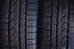 Protector of automobile tires. A number of automobile tires. Close up view on auto mobile new wheel tire s. Urface. Different pattern and type tires for car Royalty Free Stock Image