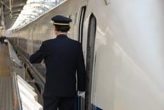 Protector en la plataforma del tren Imágenes de archivo libres de regalías