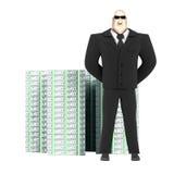 Protector y dinero Foto de archivo libre de regalías
