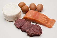 Protein. Some exemples of animal protein, eggs, cheese, fish, and Stock Photos