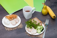 Protein breakfast with chiken, bread, egg before school, work, university on the wooden background with books