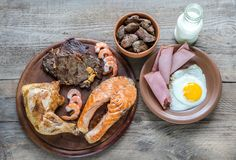 Protein diet:cooked products on the wooden background Royalty Free Stock Photography