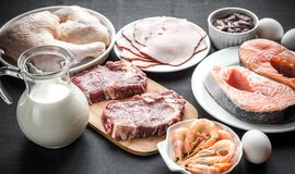 Protein diet: raw products on the wooden background. Close up Royalty Free Stock Photography