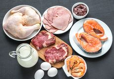 Protein diet: raw products on the wooden background. Close up Stock Photography