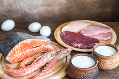 Protein diet: raw products on the wooden background Royalty Free Stock Images