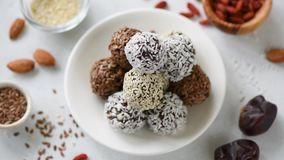 Protein energy balls vegan candy. Chocolate Protein bites, healthy energy vegan balls with dates, nuts and seeds stock video