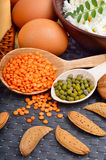 Protein food : eggs, almonds, lentils, cheese, walnut, and curd Stock Images