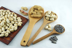 Protein from peanuts pistachio nuts and sunflower seeds Stock Photography