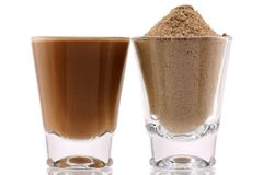 Protein Powder with Chocolate Flavor. Closeup photo of fine Protein Powder with Chocolate Flavor and Mixed with Water Stock Photos