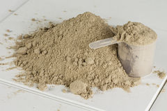 Protein Powder 2. A pile of chocolate protein powder with a scoop Stock Images