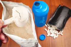 Protein powder and pills Stock Photography
