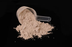 Protein powder. A scoop of chocolate whey isolate protein Stock Image