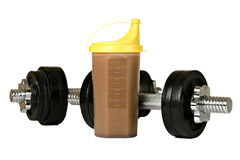 Protein shake in plastic shaker, with weights Royalty Free Stock Image