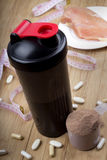 Protein shake, shaker and round scoop Royalty Free Stock Image