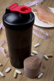 Protein shake, shaker and round scoop Royalty Free Stock Photo