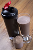 Protein shake, shaker and round scoop Royalty Free Stock Images