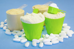Protein and tablets on blue Stock Photo