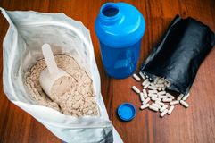 Proteine powder, BCAA pils and shaker. Healthy nutrition royalty free stock photography