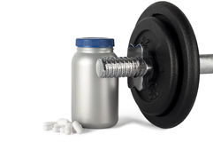 Proteins and weights. Amino acids in capsules (b.c.a.a. or  bcaa) and a handle with cast iron discs Royalty Free Stock Photography