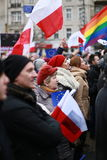 Crowd of people holding national and LGBT flags in the city center Stock Photo