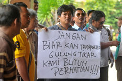 Protest against the government's policy to raise fuel prices. Public transport drivers carry a poster during protest against the government's policy to raise Stock Image