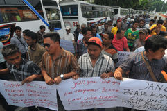 Protest against the government's policy to raise fuel prices. Public transport drivers carry a poster during protest against the government's policy to raise Stock Images