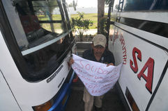 Protest against the government's policy to raise fuel prices. Public transport drivers carry a poster during protest against the government's policy to raise Royalty Free Stock Photo