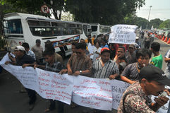 Protest against the government's policy to raise fuel prices. Public transport drivers carry a poster during protest against the government's policy to raise Stock Photography