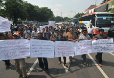 Protest against the government's policy to raise fuel prices. Public transport drivers carry a poster during protest against the government's policy to raise Royalty Free Stock Image