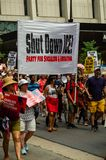 Protest against ICE and Border Patrol Detention Centers. A banner reads `Shut Down ICE! Party for Socialism  & Liberation`. Downtown, Chicago-July 13, 2019 royalty free stock photos