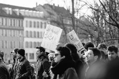 Protest against Labour reforms in France. STRASBOURG, FRANCE - 9 MAR 2016: New working law is shit palcard as thousands of people demonstrate as part of Stock Image