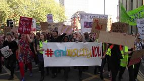 Crowd March During Austerity Protests, General Election 2015, Bristol UK. Protest against the new conservative government, public spending cuts & austerity, in stock video footage