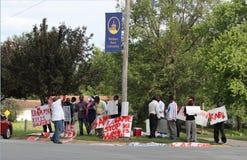 Protest against Rwandan President Kagame. A protest against Rwandan President Kagame at William Penn University, Oskaloosa, Iowa, where Kagame spoke at the royalty free stock photo