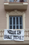 Protest banner hung on a building facade Stock Photos