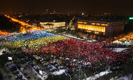 Protest in Bucharest, Romania. Protesters took to the streets the 13th day in a row with over 50.000 people demonstrating against corruption reforms gathered in Royalty Free Stock Photo