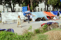 Protest Camp, Islamabad. ISLAMABAD, PAKISTAN - SEPTEMBER 24, 2014:  Supporters of Tahir ul Qadri camped along roads in the secretariat district of Islamabad in Royalty Free Stock Photo