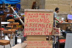 Protest camp sign in Bordeaux, France. Sign in a protest camp near a church in Bordeaux, France stock image