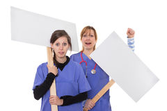 Protest campaign. Two doctors demonstrate with placards Stock Photo