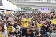 Protest Chief Executive Luggage Incident at Hong Kong Airport. Over 1,000 Cabin crew members and citizens sit-in at Hong Kong International Airport to protest Royalty Free Stock Photo