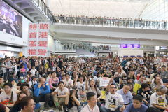 Protest Chief Executive Luggage Incident at Hong Kong Airport. Over 1,000 Cabin crew members and citizens sit-in at Hong Kong International Airport to protest Royalty Free Stock Photos