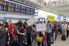 Protest Chief Executive Luggage Incident at Hong Kong Airport. Over 1,000 Cabin crew members and citizens sit-in at Hong Kong International Airport to protest Royalty Free Stock Images