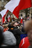 Young man looking on the national, polish flags, The protest Committee the Defense of Democracy, Poznan, Poland Stock Photography