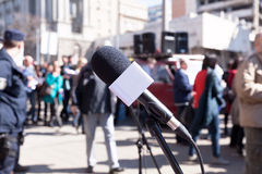Protest. Demonstration. Microphone in focus, blurred protesters in background. Stock Images