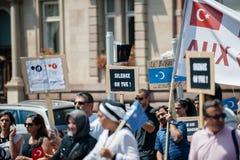 Protest för Uyghur mänsklig rättighetaktivister Arkivbild
