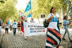 Protest för Uyghur mänsklig rättighetaktivister Fotografering för Bildbyråer